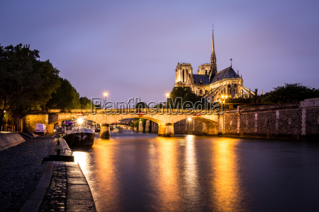 notre dame cathedral and lights reflecting