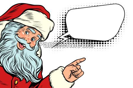 weihnachtsmann zeigt auf kopie raum