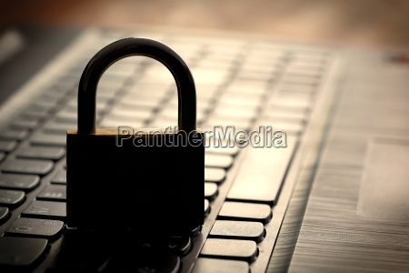 computer keyboard and padlock as a