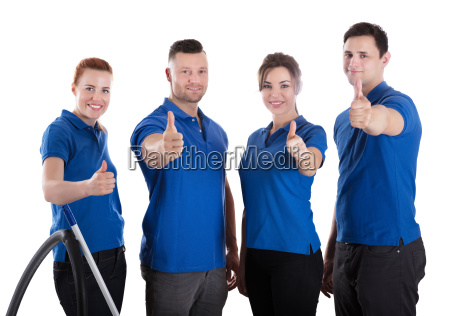 portrait of happy janitors showing thumb