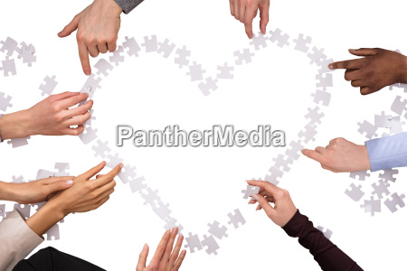 group of hands making heart shape