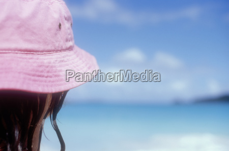 mature woman in pink sun hat