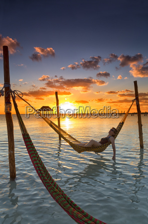 woman in hammock at sunset holbox