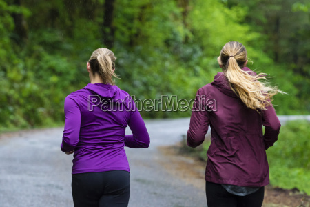 rear view of two female joggers