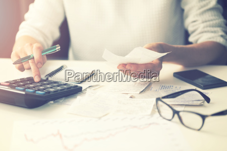 household expenses woman calculating bills