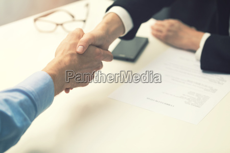 handshake after successful job interview at