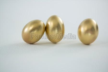 golden easter eggs on white background