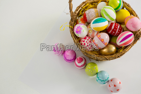 basket with painted easter eggs on