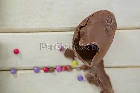 broken chocolate easter egg on wooden