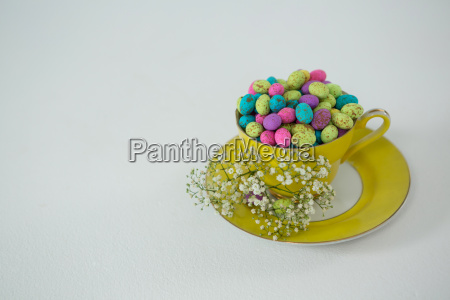 cup filled with colorful chocolate easter