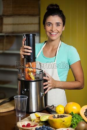 portrait of smiling shop assistant preparing