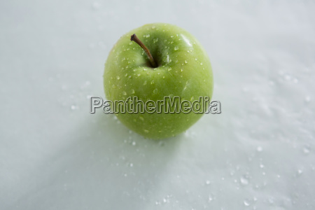 green apple with water droplets