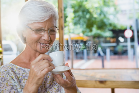 happy senior woman having coffee
