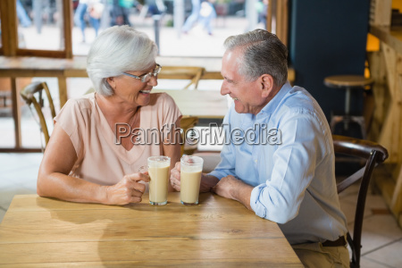 happy senior couple interacting while having