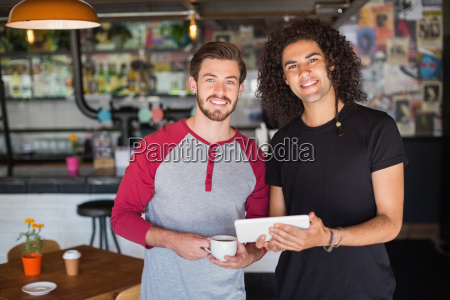 portrait of smiling young friends using