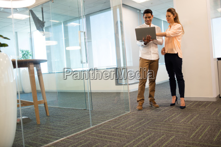 confident business people using laptop in