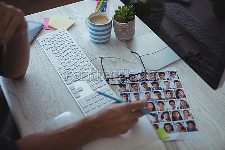 businessman working at creative office desk
