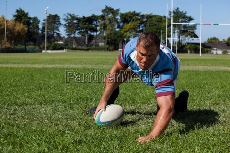 player holding ball while playing rugby