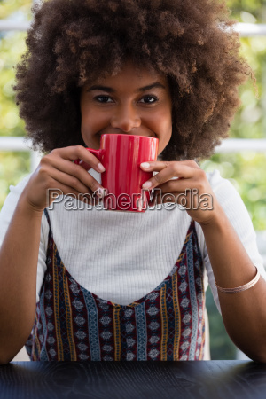 smiling woman with frizzy hair having
