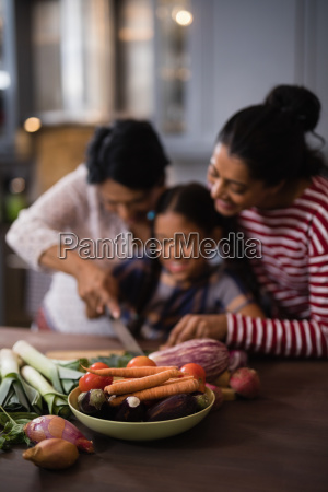 vegetables on table against multi generation