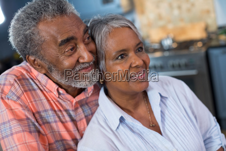 close up of thoughtful couple looking