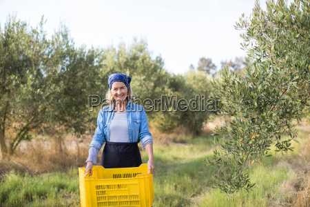 portrait of happy woman holding harvested