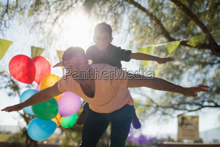 father and son enjoying together in