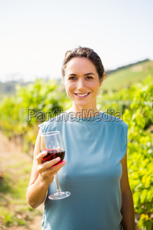 portrait of pretty woman holding red