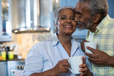 affectionate man with woman standing in