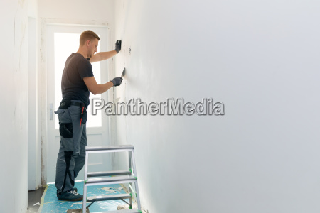 home interior construction worker repairing
