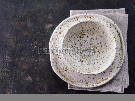 white craft plate on black slate