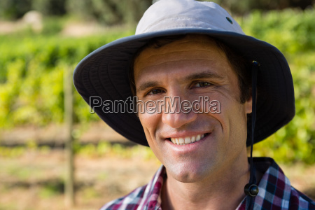 handsome farmer smiling in field on