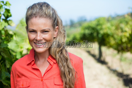 portrait of smiling woman standing in