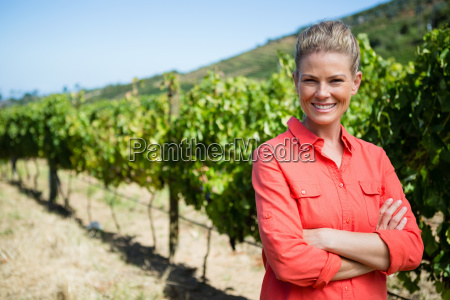 smiling woman standing with hands on