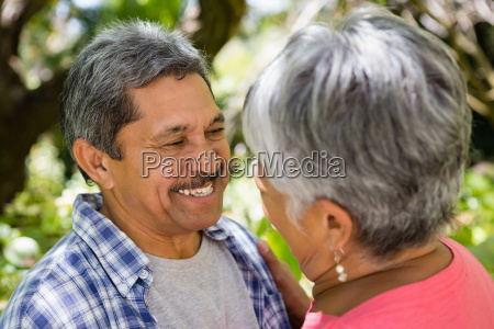 romantic senior couple looking face to
