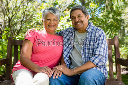 portrait of senior couple sitting with