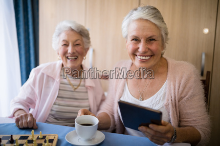 portrait of smiling senior friends having