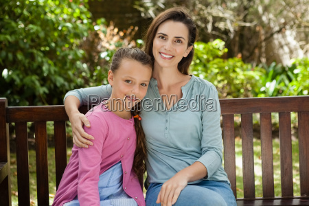 portrait of smiling woman and daughter