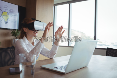 businesswoman using virtual reality technology at