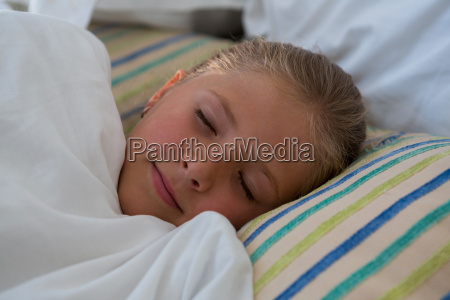 close up of girl sleeping in