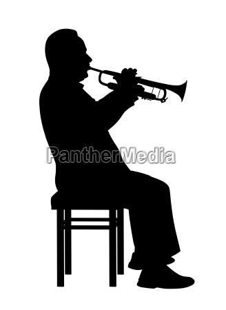 man spielt trompete