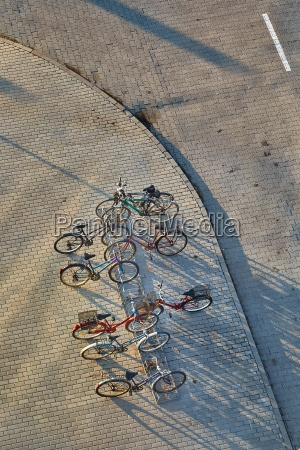 bicycles stand on a street