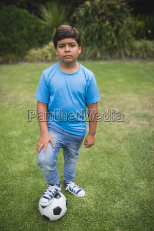 portrait of upset boy standing with