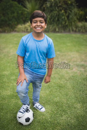 portrait of smiling boy standing with