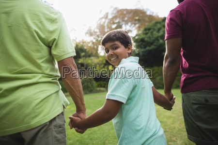 smiling boy walking with father and