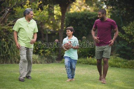 boy with father and grandfather at