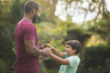 playful father and son enjoying at