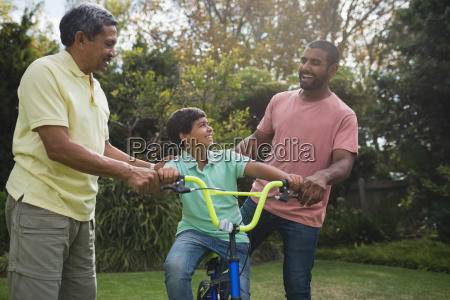 happy father and grandfather with boy