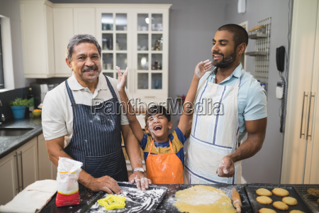 cheerful boy standing with father and