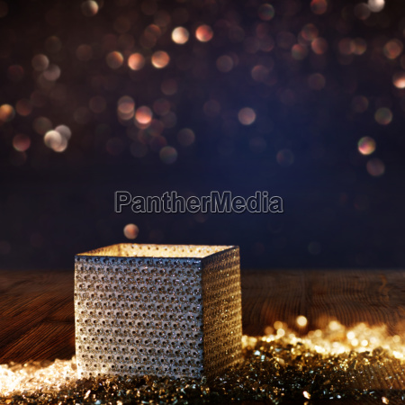bright radiant gift box with bokeh